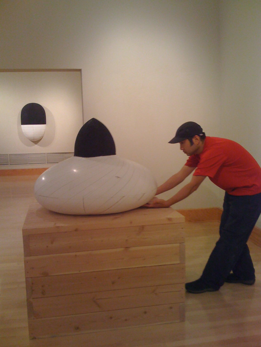 Hiroyuki Hamada installing his sculpture in the List Gallery, Swarthmore College