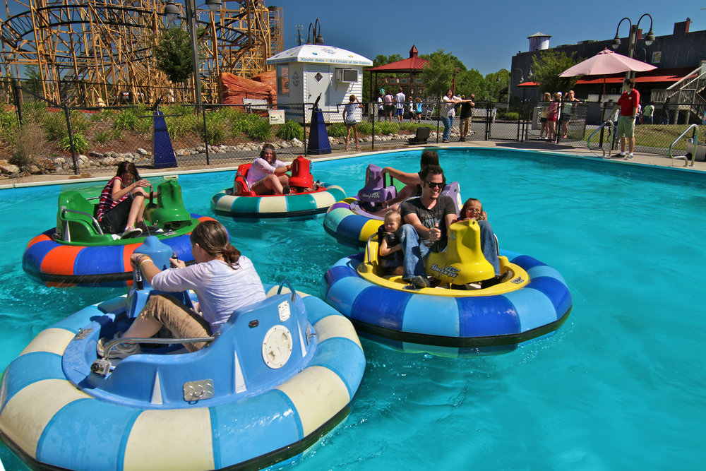 Sail around Adventure Park USA's Crater Lake in a Shockwave Bumper Boat on a hot summer day.