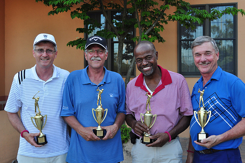 Jim Childs, Roy Gotta, Ken Davis, and Curt Johns hold their first place trophies for the 2013 ABCNJ Golf Classic
