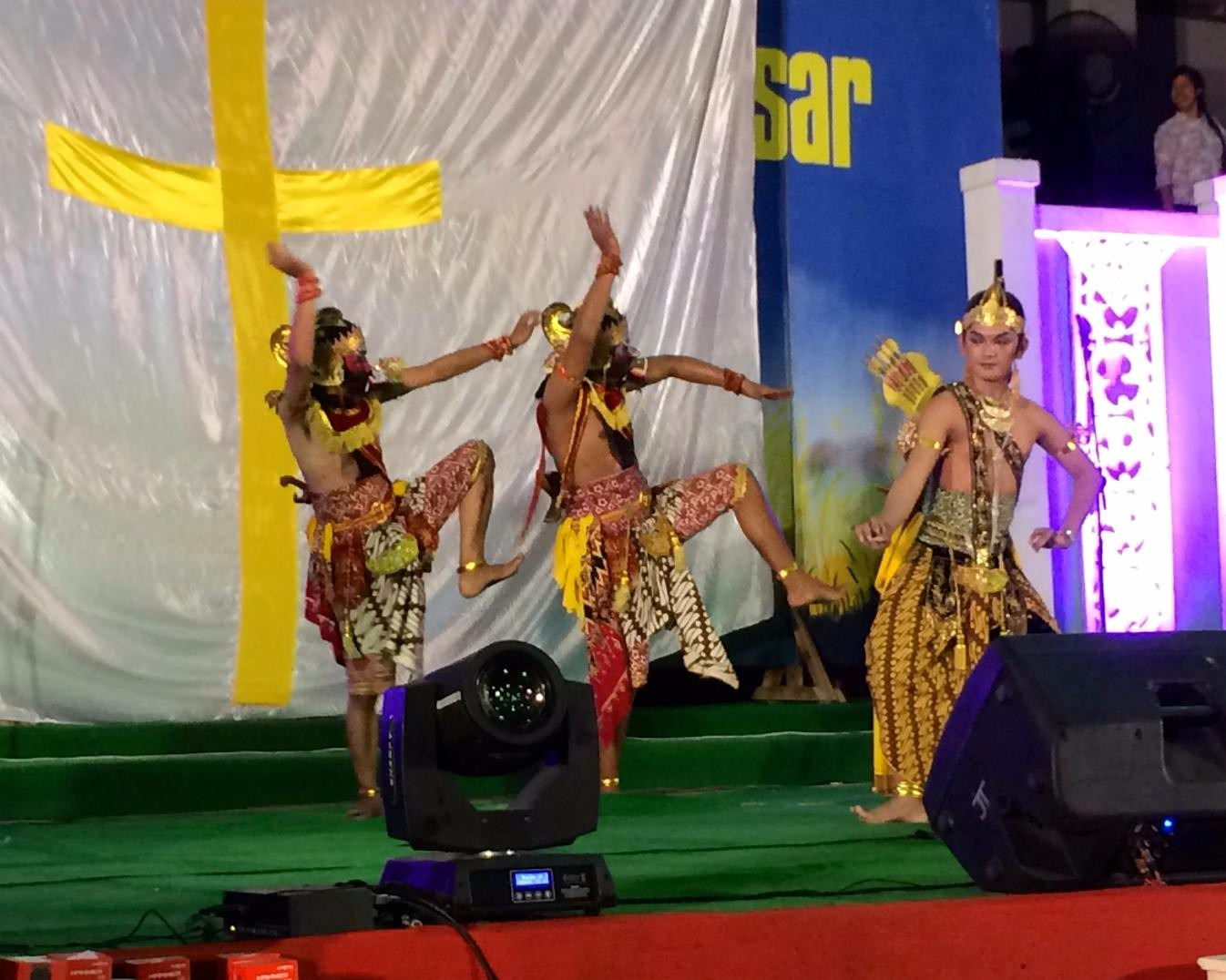 The forces of chaos and conflict meet harmony and reconciliation in a traditional dance at the Indonesian Baptists' anniversary celebration. Which one represents the missionary?