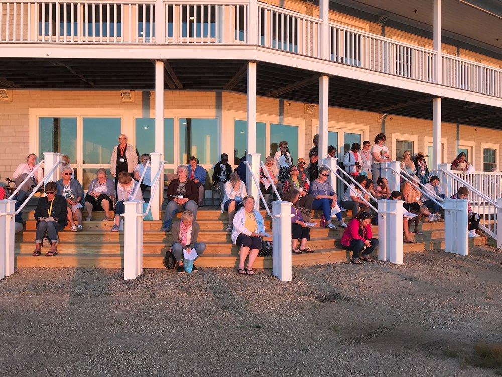 The women enjoy the sunset at Harvey Cedars.