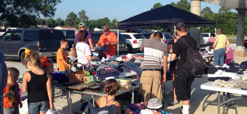 back to school uniform give away and community garage sale.