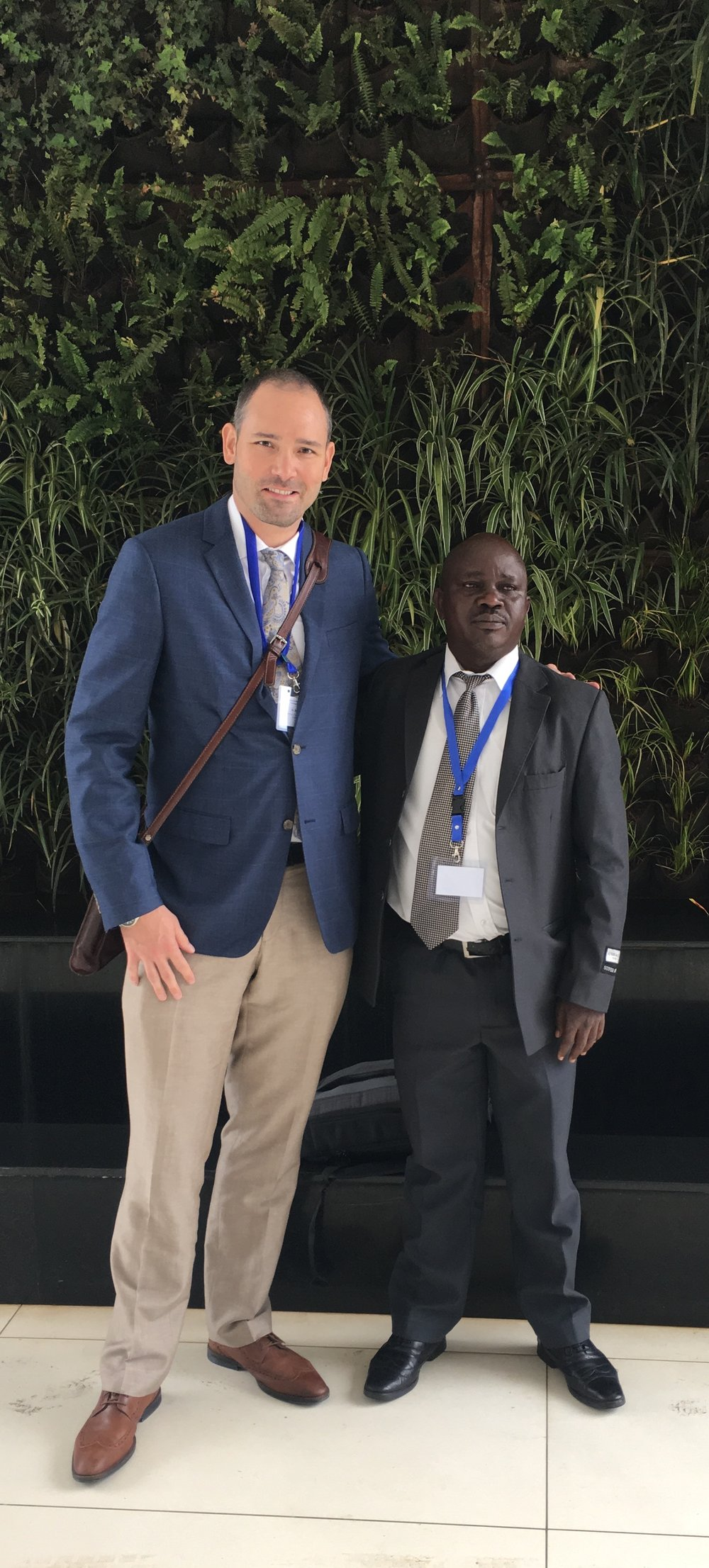 Image 3:Brent Elder of Rowan University and Tangata Group (left) stands with Benson Oswago of the Ministry of Education in Kenya (right).