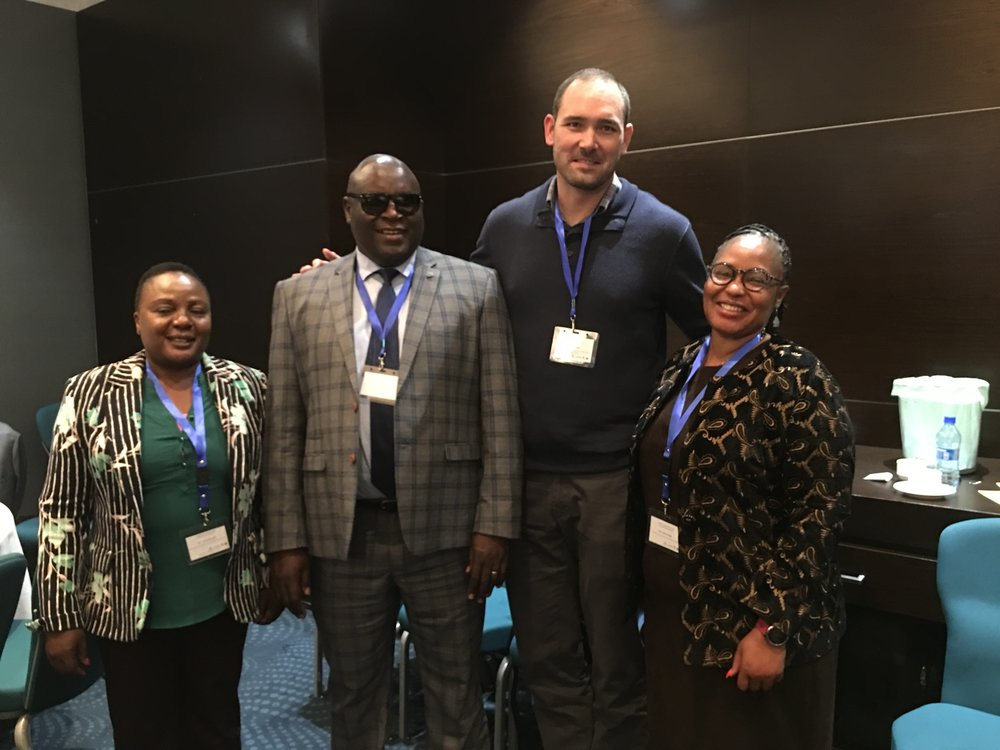 Anne Musalia of the Kenyan Ministry of Education, Quality Assurance and Standards (left), Fred Haga, the KenyanDeputy Director in the Directorate of Special Needs Education(second from the left), Brent Elder of Rowan University and Tangata Group (third from left), and Lydia Chege the Deputy Director of Finance and Administration of the Kenya Institute of Special Education (far right), pose for a photo.