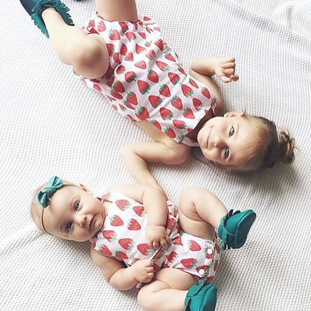 Adorable rompers handmade by HelloEllie.Shop using the Strawberries - Watercolor design.