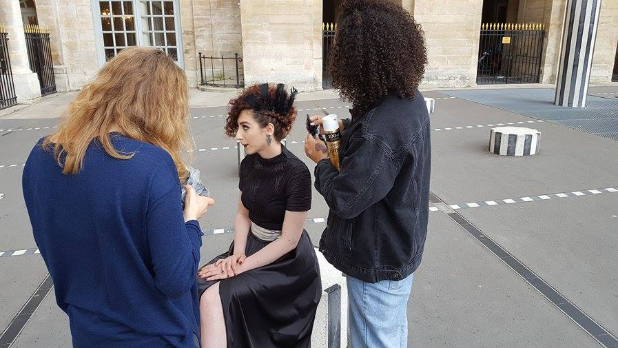 On location: Le Palais Royal - Hair touch-ups during the big shoot!