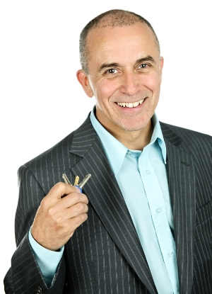 stock-photo-portrait-of-smiling-businessman-holding-keys-isolated-on-white-background-55062682.jpg