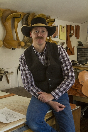 This portrait of Justin Thorson, saddle maker, is flat without flash.