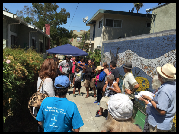 (A crowd gathers for a neighborhood celebration of the Carrington pathway and steps)