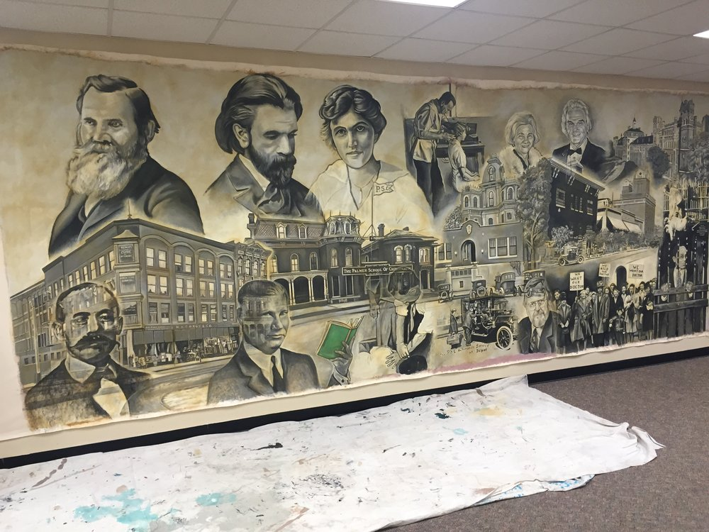 The mural being installed on location at Life Chiropractic West College.