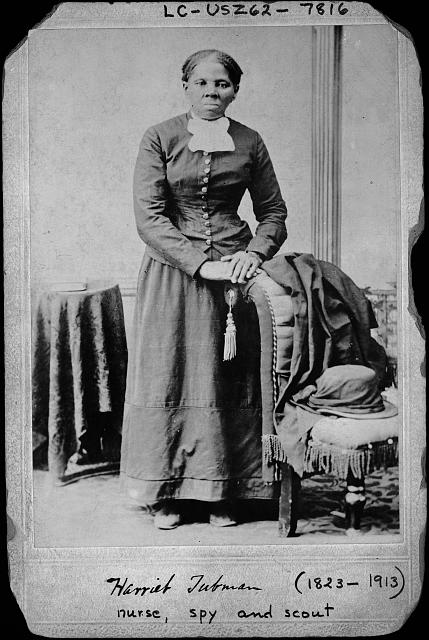 [Harriet Tubman, full-length portrait, standing with hands on back of a chair] Photo Credit: Library of Congress Prints and Photographs Division.