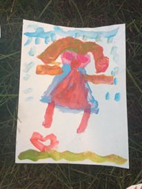 This painting was done by a young girl who is here as a refugee from Nepal
