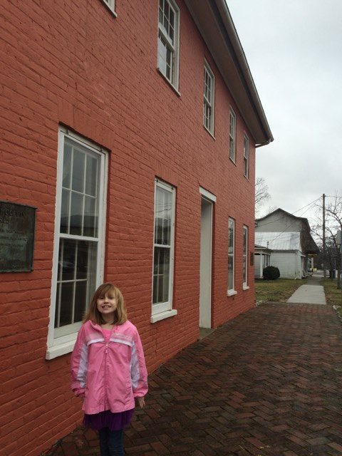 Ellie in front of the Levi Coffin home