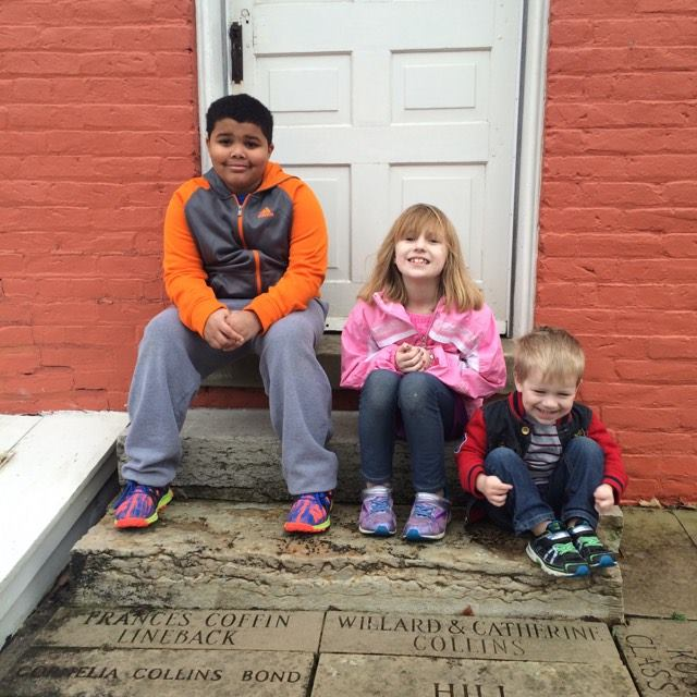 Roman, Ellie, & Micah in front of the Levi Coffin home