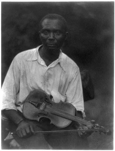 African American man, seated, holding violin. Library of Congress, Prints and Photographs Division