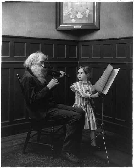 Bearded man playing violin and girl turning pages of music. Library of Congress Prints and Photographs Division.