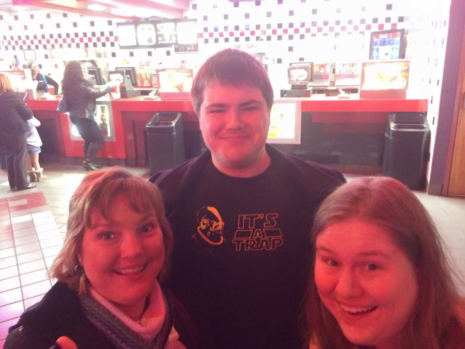 My mother, brother, and I being big nerds standing in line at the theater to see Episode VII in December 2015