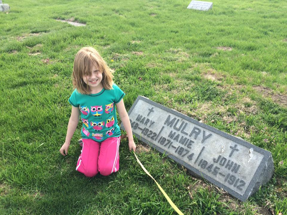My daughter Ellie with her 4th great-grandparents, John & Mary Ellen Mulry at Holy Cross Cemetery, Indianapolis, Indiana