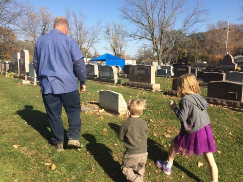 My dad giving my kids a little tour of a cemetery in Kokomo, Indiana