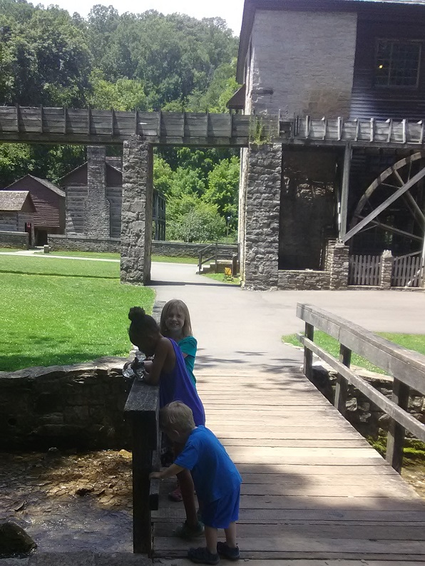 The kiddos in front of the mill
