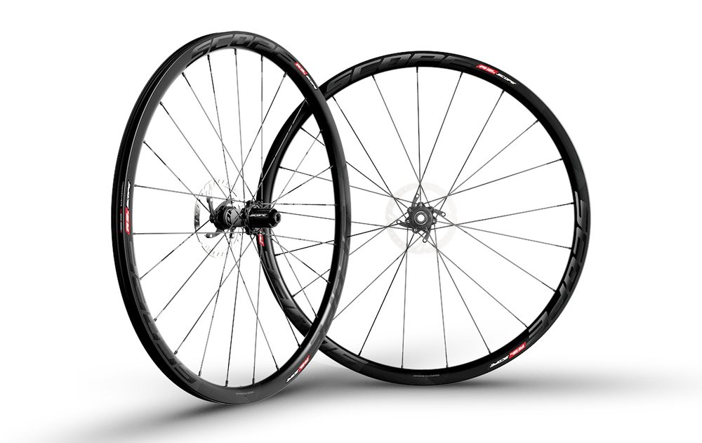 - Carbon Clincher disc brake  - Rim width: 26mm // Rim depth: 30mm  - Tubeless ready  - Sapim CX-Ray Spokes  -  Scope Hubs // Centerlock rotor mount  - Weight: 1,457g  - $1,290 (with purchase of frame, price includes tubes and tires)