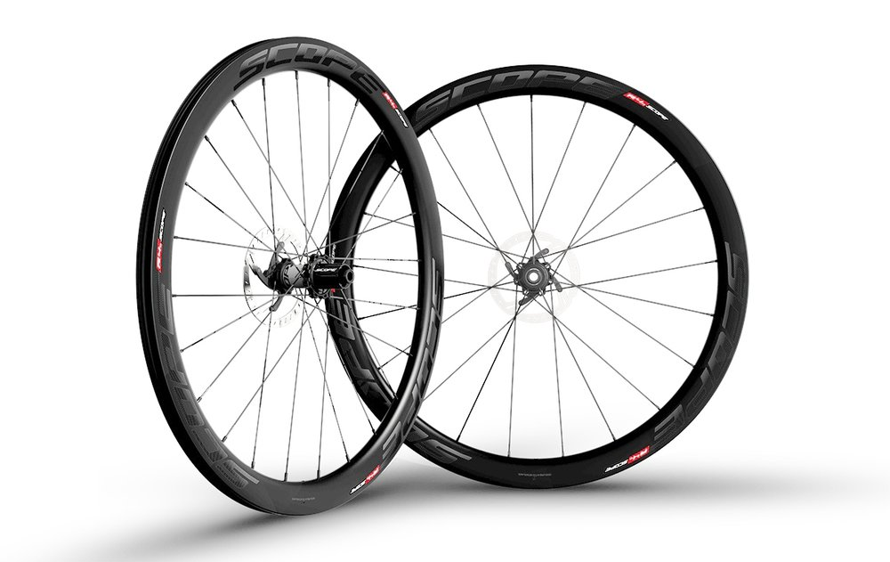 - Carbon Clincher disc brake  - Rim width: 26mm // Rim depth: 45mm  - Tubeless ready  - Sapim CX-Ray Spokes  - Scope Hubs // Centerlock rotor mount  - Weight: 1,557g  - $1,290 (with purchase of frame, price includes tubes and tires)