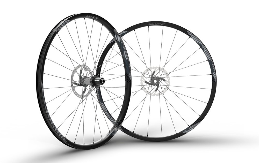 - Carbon Clincher disc brake  - Rim width: 25/31mm // Rim depth: 23mm  - Tubeless ready  - Sapim Laser Spokes  -  Scope Hubs // Centerlock rotor mount  - Weight: 1,457g  - $1,290 (with purchase of frame, price includes tubes and tires)