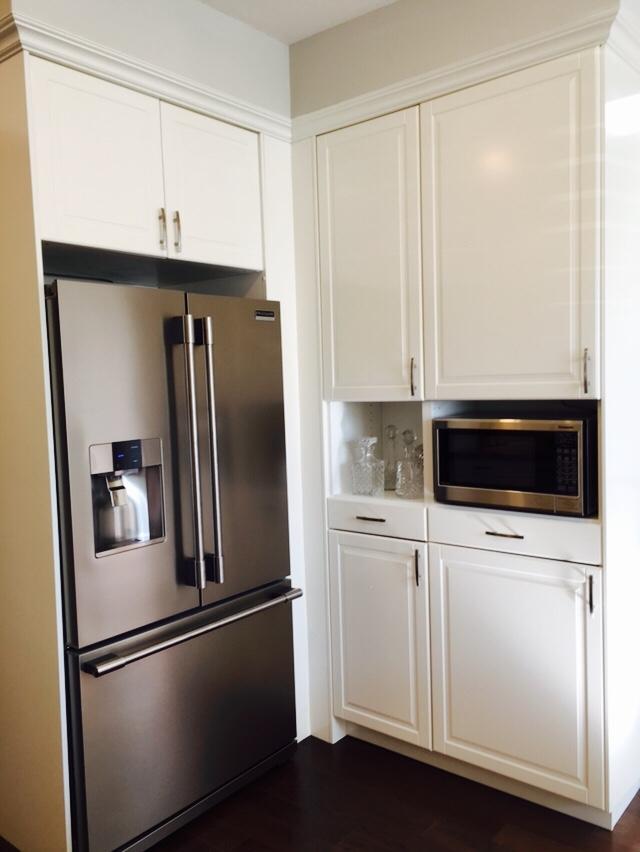 Kitchen bulkhead trim cabinets.JPG