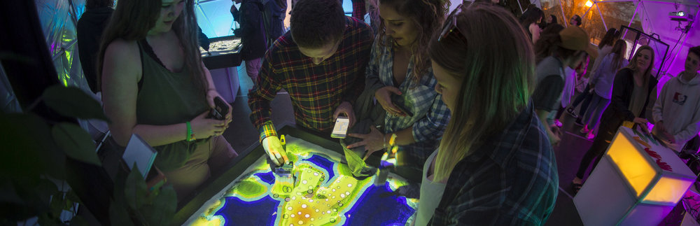 Sandbox of Life Interactive Art Installation with Augmented Reality Projection Mapping
