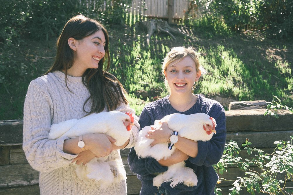 Claire and her sister Lily, holding their happy free range hens