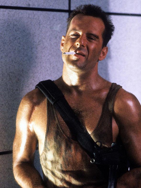Bruce Willis as John McClane.