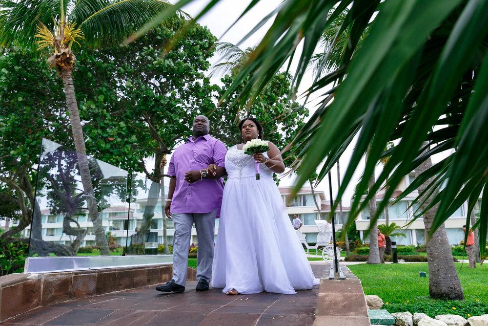 tressa-how-to-plan-a-destination-wedding-in-cancun-mexico-moon-palace-resort-black-destination-bride-destiland-desti-guide-to-destination-weddings-bride-entrance.jpg