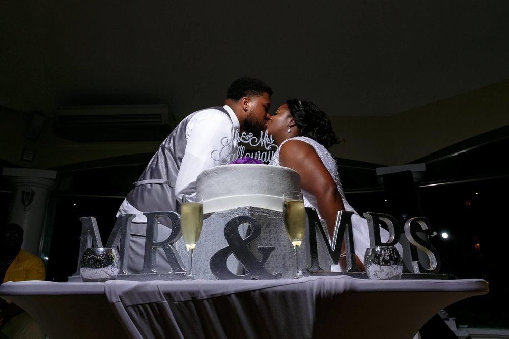 tressa-how-to-plan-a-destination-wedding-in-cancun-mexico-moon-palace-resort-black-destination-bride-destiland-desti-guide-to-destination-weddings-cake-kiss.jpg