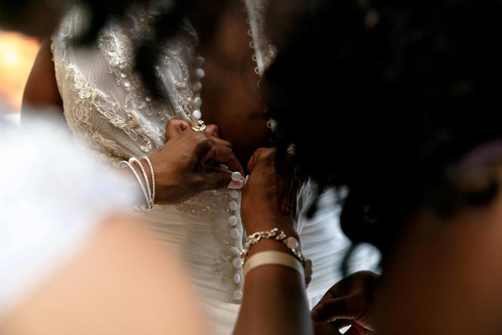 tressa-how-to-plan-a-destination-wedding-in-cancun-mexico-moon-palace-resort-black-destination-bride-destiland-desti-guide-to-destination-weddings-beach-wedding-buttons.jpg