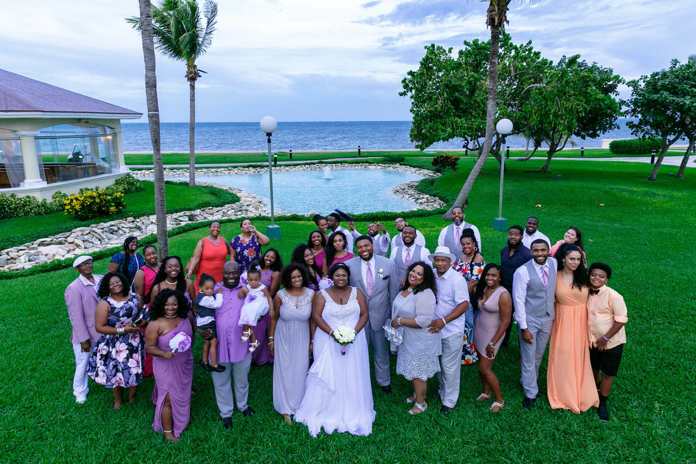 tressa-how-to-plan-a-destination-wedding-in-cancun-mexico-moon-palace-resort-black-destination-bride-destiland-desti-guide-to-destination-weddings-beach-wedding-family1.jpg