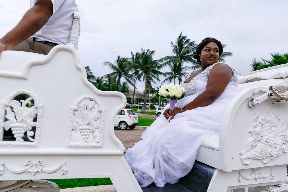 tressa-how-to-plan-a-destination-wedding-in-cancun-mexico-moon-palace-resort-black-destination-bride-destiland-desti-guide-to-destination-weddings-beach-wedding-horse-carriage.jpg