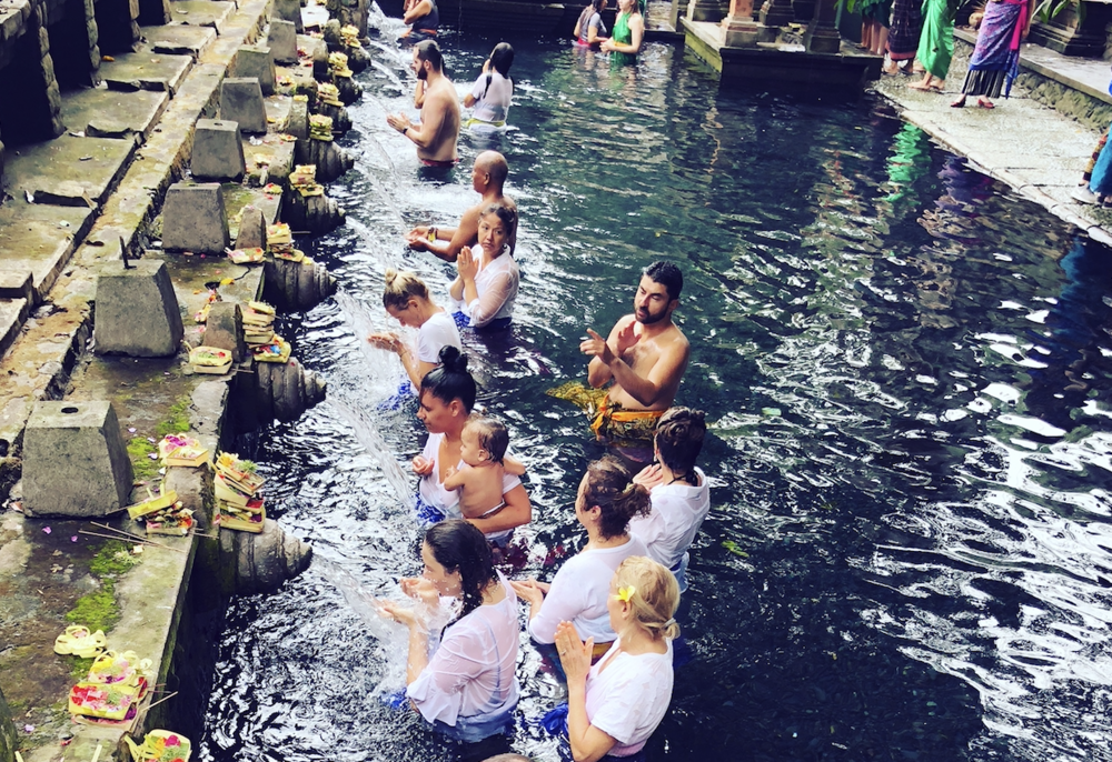 Purification ritual in the holy spring water at the Tirta Empul Sacred Water Temple -