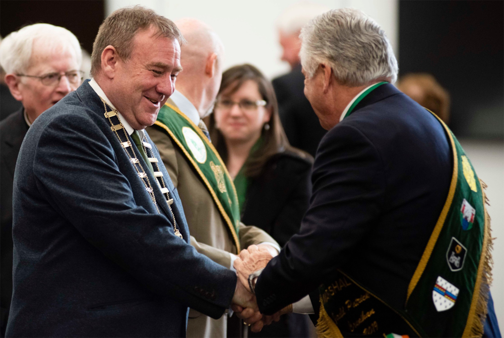Above: During the reception,    Keith Doyle    (left), Chair of Wexford County Council, receives a warm greeting from    Jerry Counihan    (right), the Grand Marshal of the 2019 Savannah St. Patrick's Day Parade.