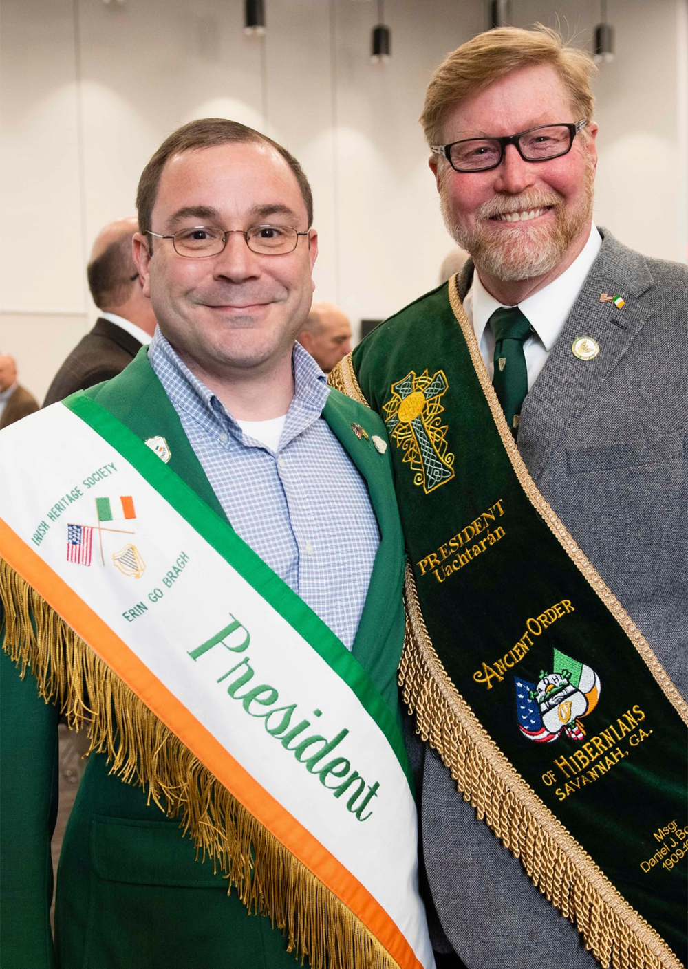 Above:    Robert P. Grayson    (left), President, Irish Heritage Society of Savannah, and    Walt Harper    (right), President, Monsignor Daniel J. Bourke Division (#1 Savannah), Ancient Order of Hibernians in America. Presidents and other officers of each of Savannah's 15 Irish organizations attended the Announcement Event. During the reception, they connected in a spirit of camaraderie. Also in attendance were the President and multiple members of the Irish Heritage Society of Sun City-Hilton Head, a community in the state of South Carolina, just north of Savannah.
