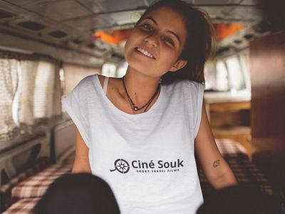 Ciné Souk Vlogger in camper van smiling.png
