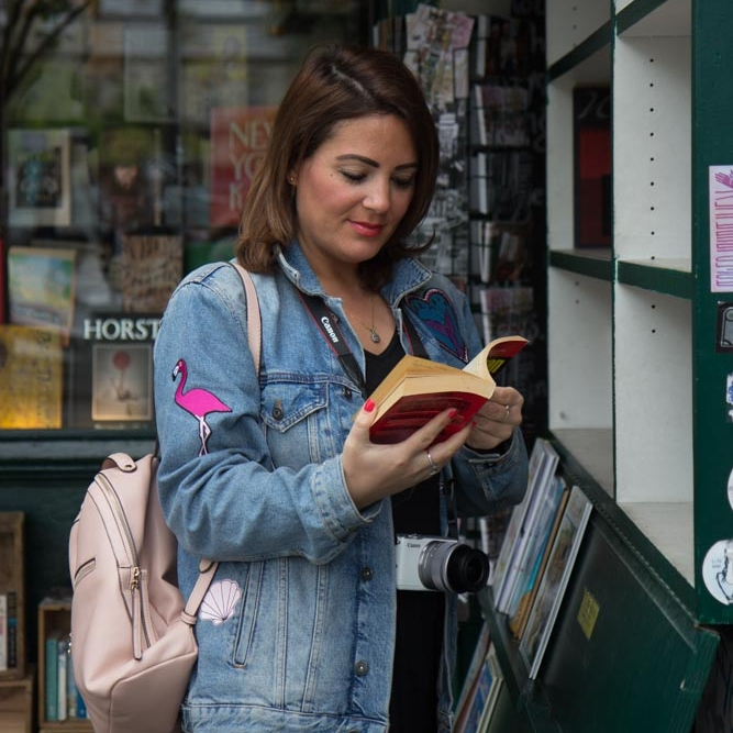 Reading books in Shakespheare & co bookstore in Paris