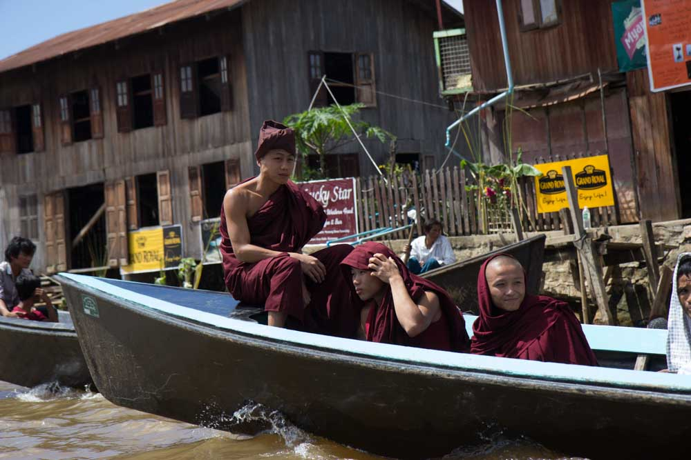 Monks on the river in Myanmar