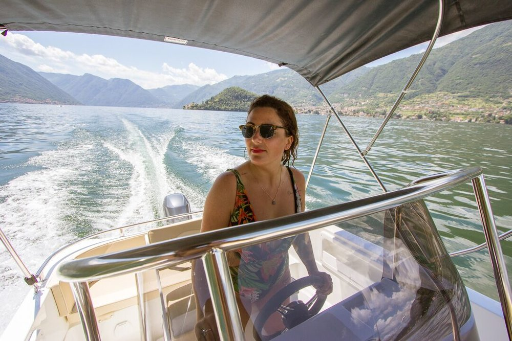 driving a power boat on lake como