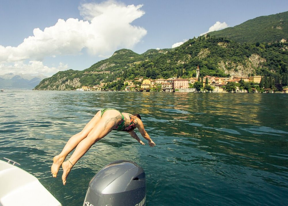 diving off the boat on Lake Como, Italy