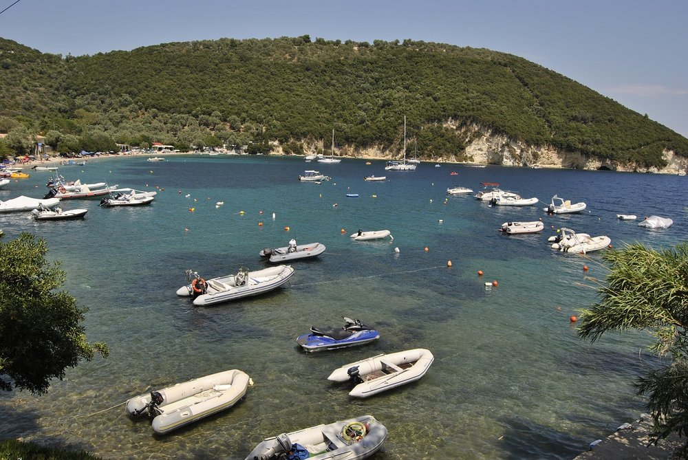 One of the beach bays on Lefkada island filled with power boats