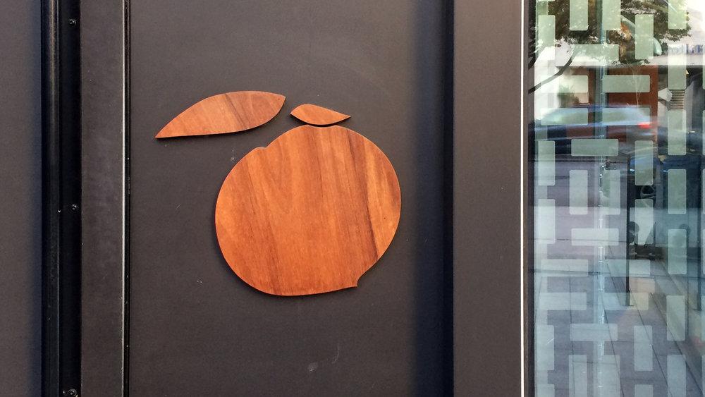 Momofuku - Door Peach Sign Design