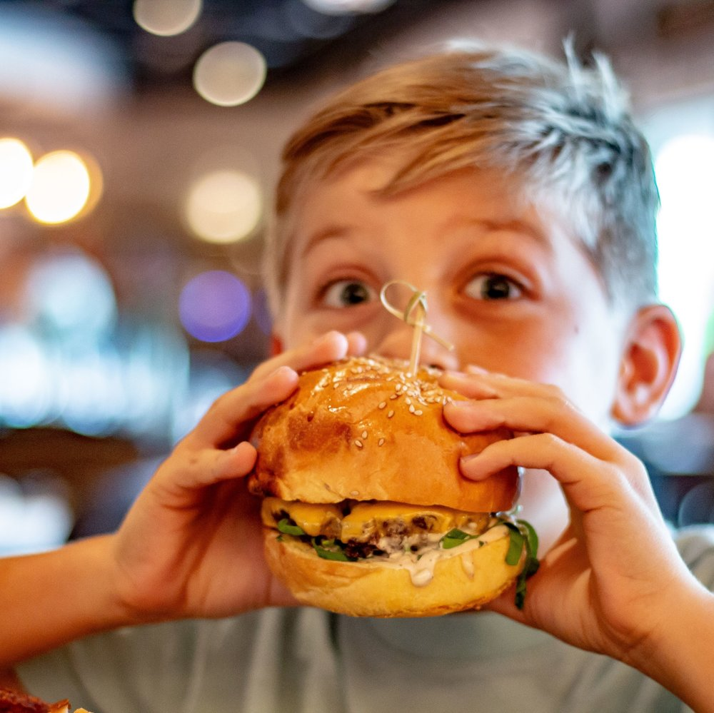 We Have Kids Too! - Tuesdays Kids eat FREE!* Choice of Kid Burger & Fries (with Shake), Fried Chicken, or The Basic Flatbread.*1 kids meal free with the purchase of each adult entree. Ages 12 and under only.