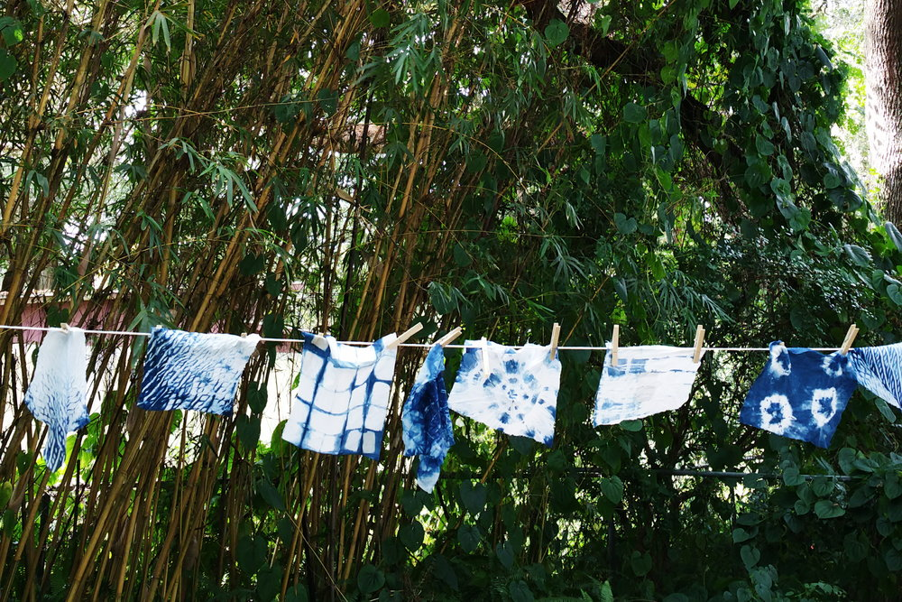 clothesline of student work during  intro to indigo and shibori dyeing