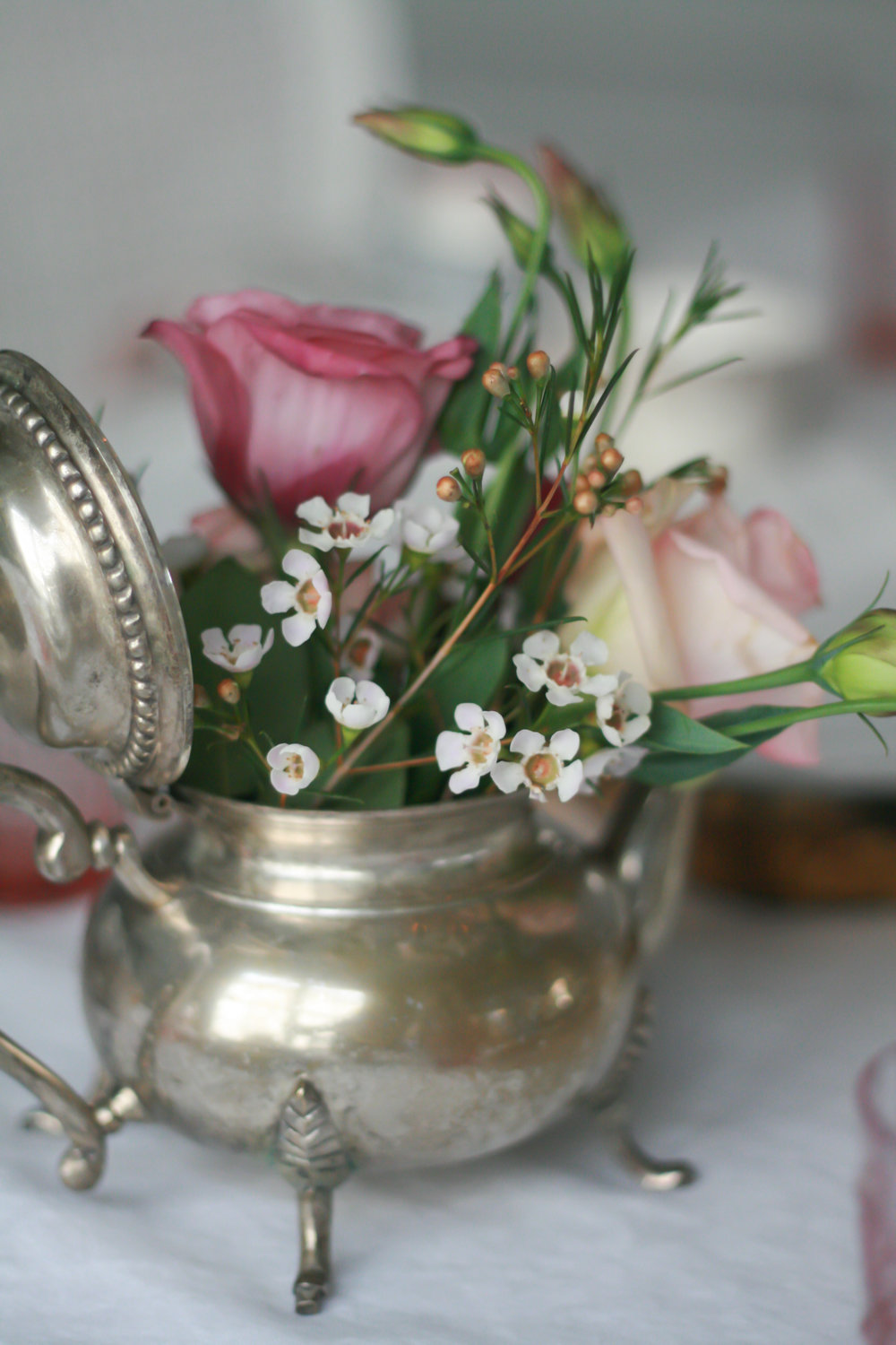 I ordered some old silver teapots from Etsy and filled them with fresh flowers.