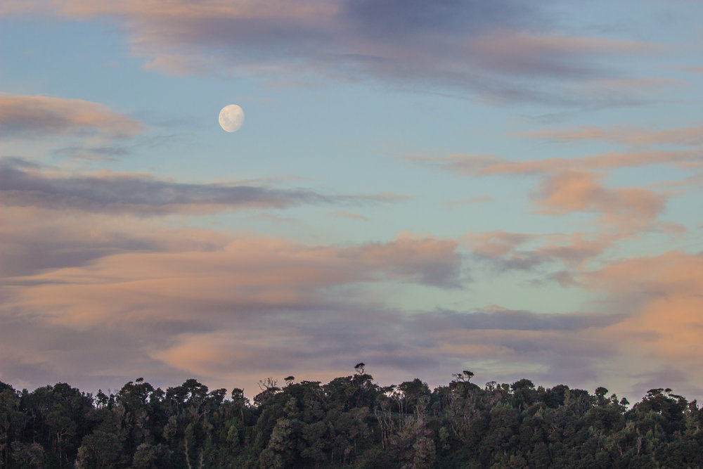 Sunset light and the moon seen from the lookout tower in Inío.